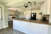 kitchen showing working surface, fireplace, oven and fridge/freezer