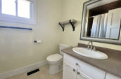 toilet and basin with large mirror